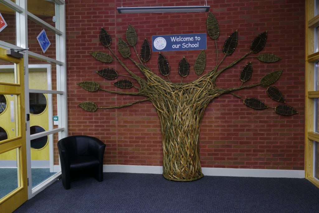 Welcoming tree in foyer, Saughall Primary School, with leaves made with pupils